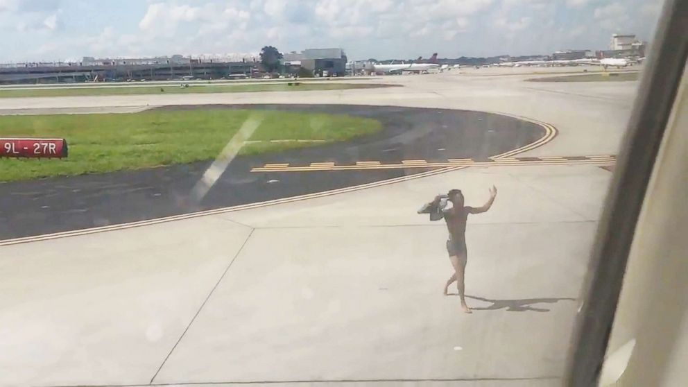 Man Jumps Onto Wing