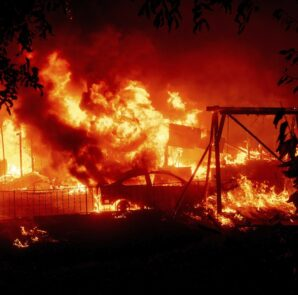 Flames consume a home and car